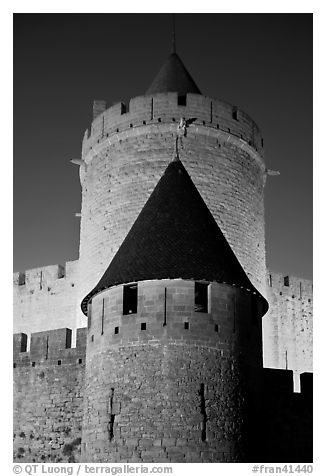 Towers with witch hat roofs by night. Carcassonne, France (black and white)