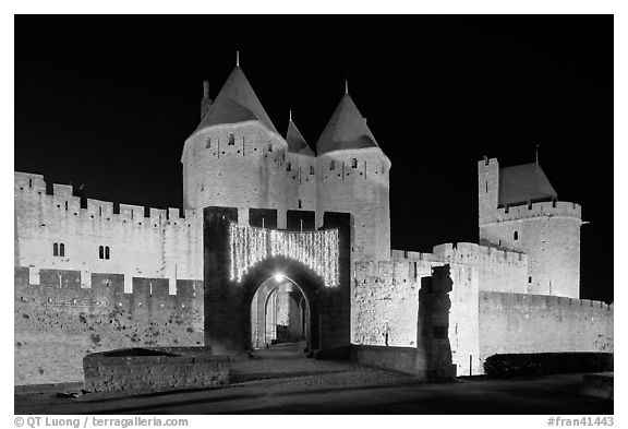 Medieval city and main entrance by night. Carcassonne, France (black and white)