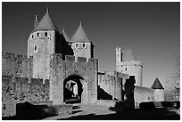 Main entrance of fortified city and drawbridge. Carcassonne, France (black and white)