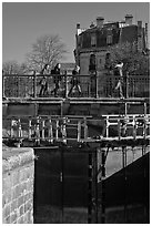 Pedestrians walking on brige above Canal du Midi. Carcassonne, France (black and white)