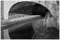 Stone bridge across Canal du Midi. Carcassonne, France (black and white)
