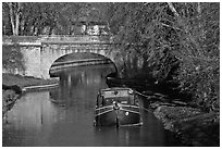 Tranquil scene with barge, bridge, and trees, Canal du Midi. Carcassonne, France ( black and white)