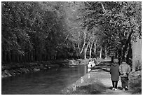 Couple walking along Canal du Midi. Carcassonne, France (black and white)
