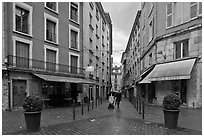 Pedestrian street with couple pushing stroller. Grenoble, France ( black and white)