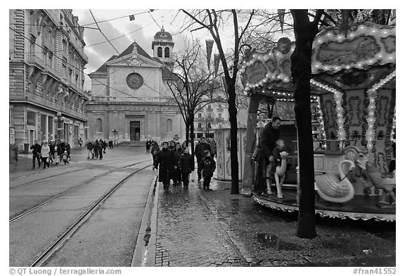 Street carousel and church. Grenoble, France (black and white)