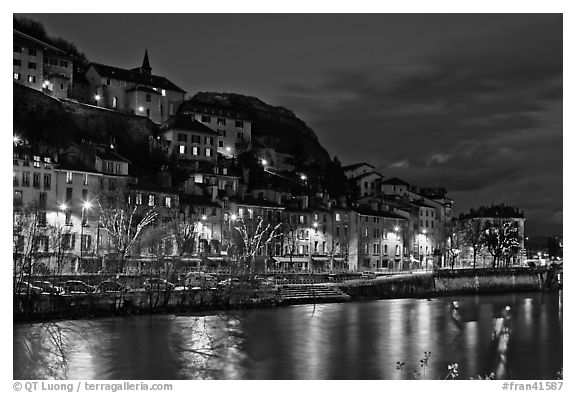 Night view with Isere River and illuminations reflected. Grenoble, France (black and white)