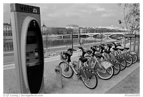 Bicycles for rent with automated kiosk checkout. Lyon, France (black and white)