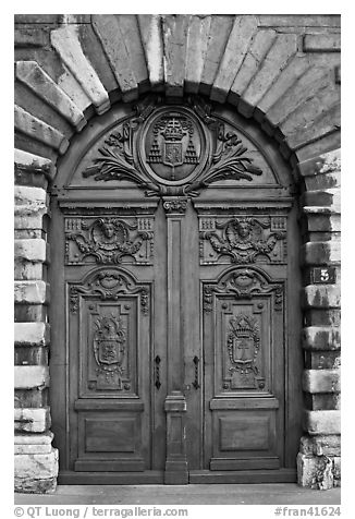 Historic wooden door. Lyon, France (black and white)