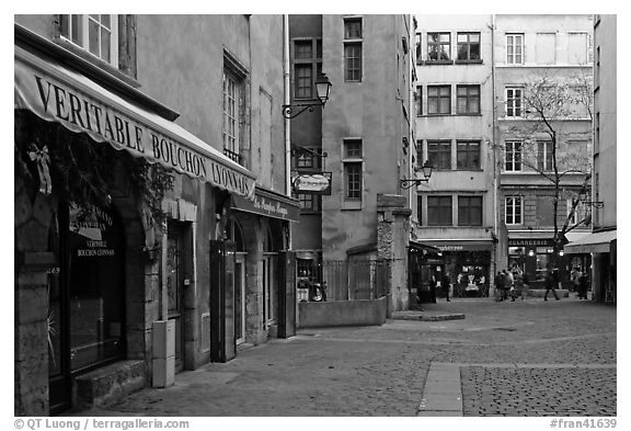 Square with restaurant offering the local specialty bouchon lyonnais. Lyon, France (black and white)
