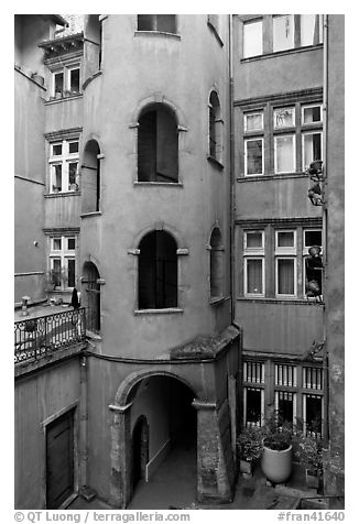 Base of the Tour Rose with traboule passageway. Lyon, France (black and white)