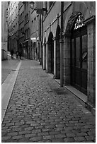 Cobblestone pavement on historic distric street. Lyon, France (black and white)