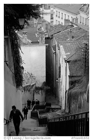 People climbing stairs to Fourviere Hill. Lyon, France (black and white)