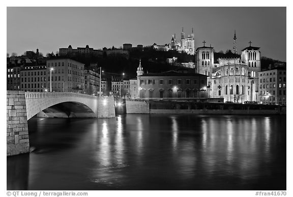 Napoleon Bridge, Saone River and Fourviere Hill at night. Lyon, France (black and white)