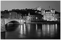 Napoleon Bridge, Saone River and Fourviere Hill at night. Lyon, France ( black and white)