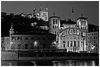 Saint Jean Cathedral and Notre Dame of Fourviere basilica at night. Lyon, France (black and white)