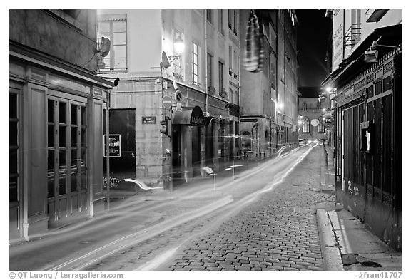 Street with light trails left by cars. Lyon, France (black and white)
