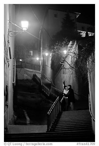 Couple embrassing romantically on stairs to Fourviere Hill. Lyon, France (black and white)