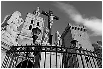 Crucifix in front of Notre-Dame-des-Doms Cathedral. Avignon, Provence, France ( black and white)