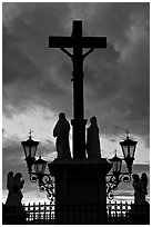 Cross and statues with sunset clouds. Avignon, Provence, France ( black and white)