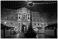Christmas fair and City hall at night. Avignon, Provence, France ( black and white)