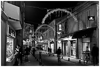 Commercial street at night. Avignon, Provence, France ( black and white)