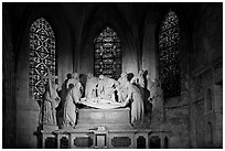 Lit sculpture of Christ laid to rest, St Trophime church. Arles, Provence, France (black and white)