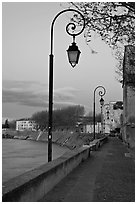 Walkway on the banks of the Rhone River at dusk. Arles, Provence, France (black and white)