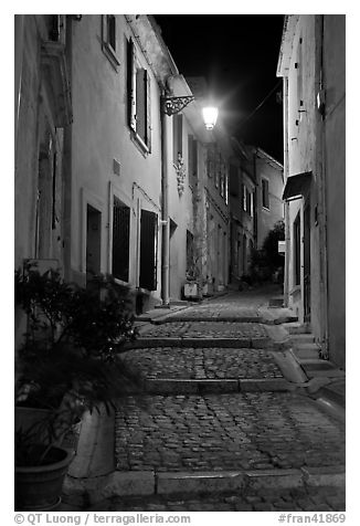 Cobblestone passageway with stepts at night. Arles, Provence, France (black and white)