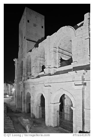 Arenes Roman amphitheater with defensive tower at night. Arles, Provence, France (black and white)