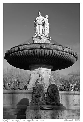 Monumental fountain with three statues representing art, justice and agriculture. Aix-en-Provence, France (black and white)