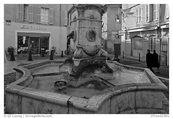 Fountain in old town plaza. Aix-en-Provence, France (black and white)