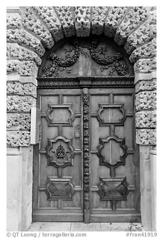 Decorated wooden door. Aix-en-Provence, France (black and white)