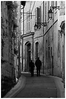 Couple walking in old street. Arles, Provence, France ( black and white)