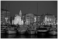 Yachts, church, and city at night, Vieux Port. Marseille, France ( black and white)
