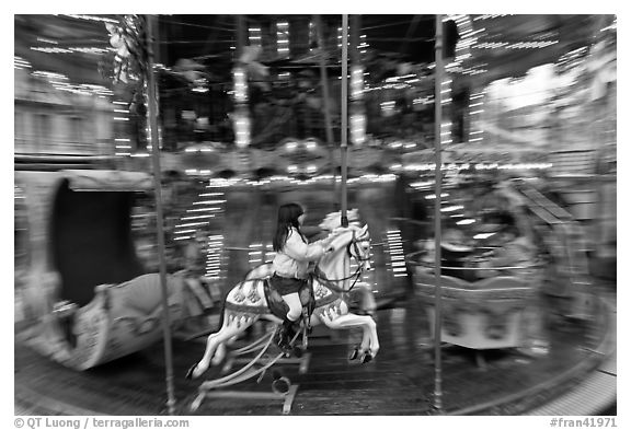 Girl on horse carousel. Avignon, Provence, France (black and white)