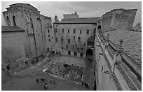 Honnor courtyard and walls from above, Palace of the Popes. Avignon, Provence, France (black and white)
