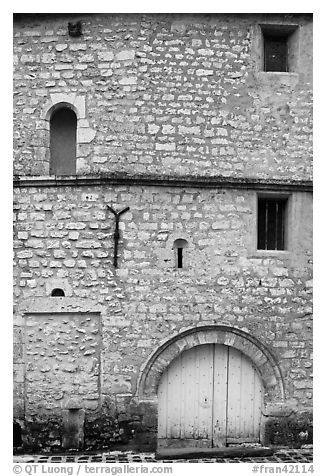 Facade detail of medieval house with small windows, Provins. France (black and white)