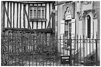Fence, stone house, and half-timbered house, Provins. France (black and white)
