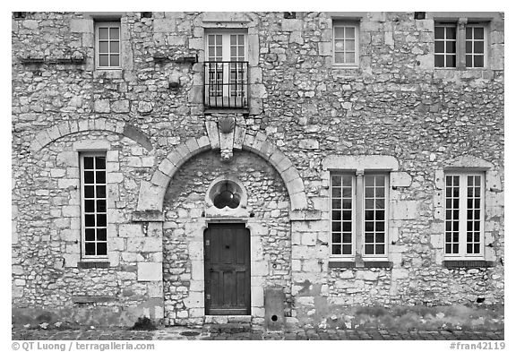 Facade of stone house, Provins. France (black and white)
