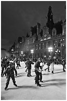 Holiday skaters, Hotel de Ville by night. Paris, France (black and white)
