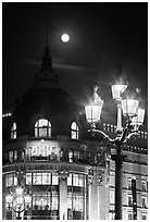 Street lamps, BHV department store, and moon. Paris, France (black and white)