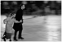 Man skating with daughter by night. Paris, France (black and white)