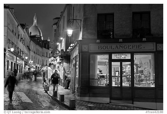 Bakery, street and dome of Sacre-Coeur at twilight, Montmartre. Paris, France (black and white)