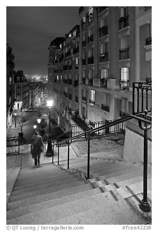 Woman on stairs by night, Montmartre. Paris, France (black and white)