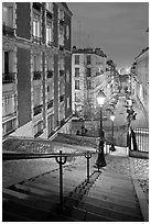 Stairs and street lamps by night, Butte Montmartre. Paris, France (black and white)