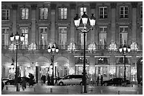 Lights and palace-like classical fronts of Hotel Ritz by Jules Hardouin-Mansart. Paris, France ( black and white)