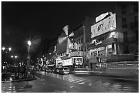 Boulevard by night with Moulin Rouge. Paris, France (black and white)