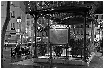 Subway entrance with art deco canopy by night. Paris, France ( black and white)