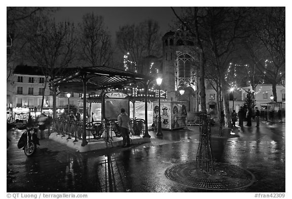 Public square on rainy night. Paris, France (black and white)