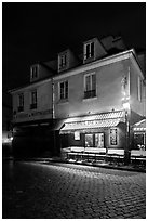 Houses with restaurant at street level, Montmartre. Paris, France (black and white)